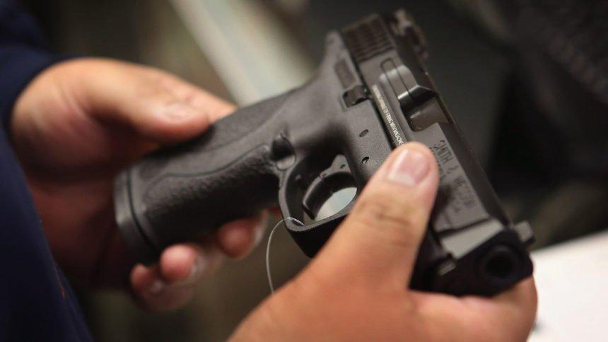 man holding handgun.jpg_39048169_ver1.0_1280_720