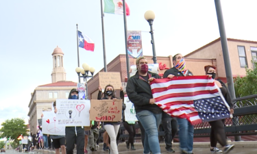 Protesters against police brutality near Pueblo Riverwalk Monday night.