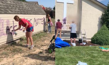 Community members clean graffiti Sunday afternoon.