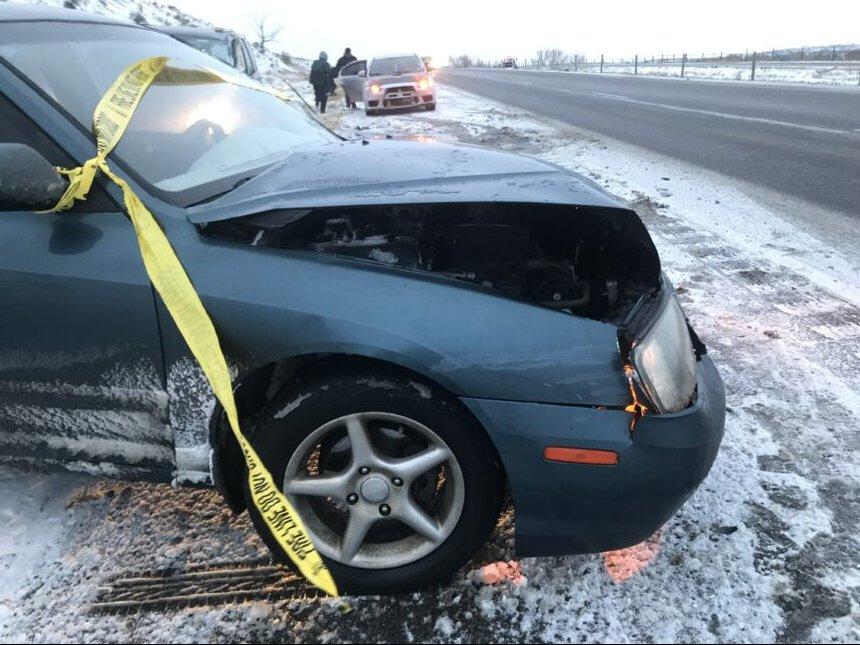 Damaged car that slid off the highway on I-25 south Sunday.