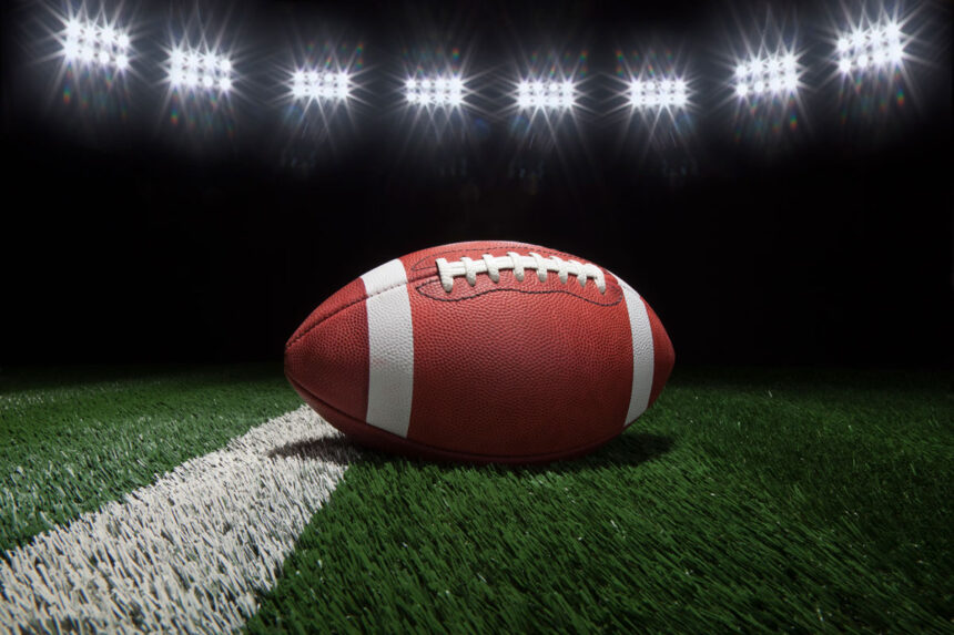 college-football-on-field-with-dark-background-and-PA7UF5Y