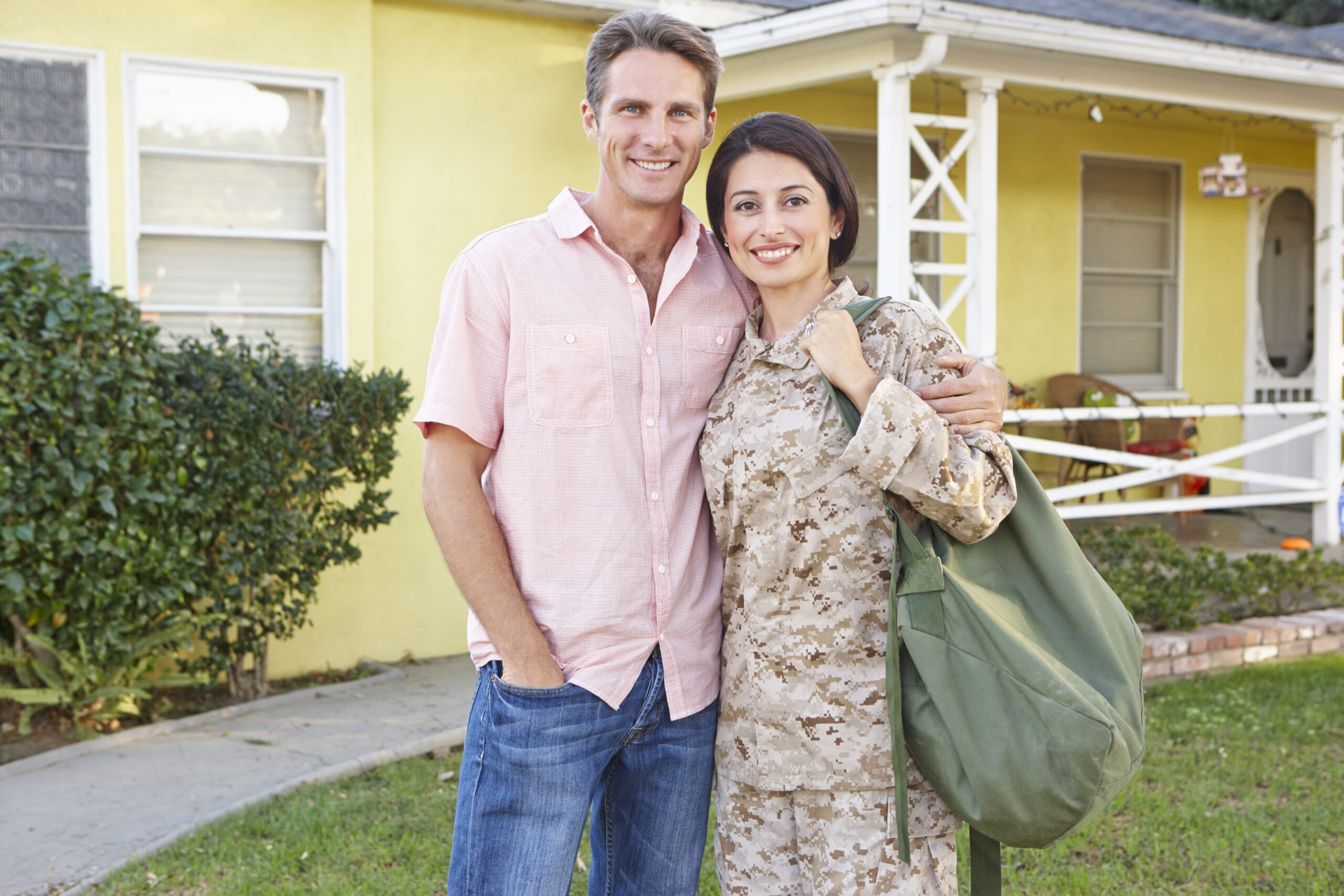 Husband Welcoming Wife Home On Army Leave