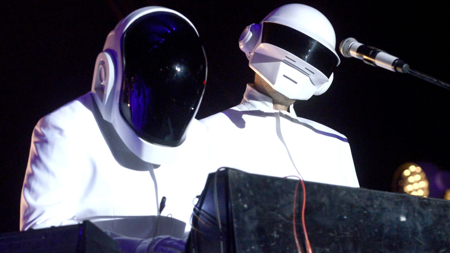 INDIO, CA - APRIL 20:  Guests dressed as Daft Punk performs with Arcadw Fire at the Coachella Valley Music and Arts Festival at The Empire Polo Club on April 20, 2014 in Indio, California.  (Photo by Tim Mosenfelder/WireImage)