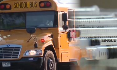 School bus and vaccine syringes