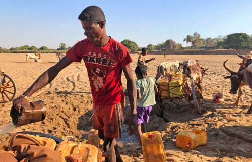 Men dig for water in the dry Mandrare river bed in Madagascar on November 9