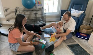 Jessica Rapp and Jake Irwin play with their son