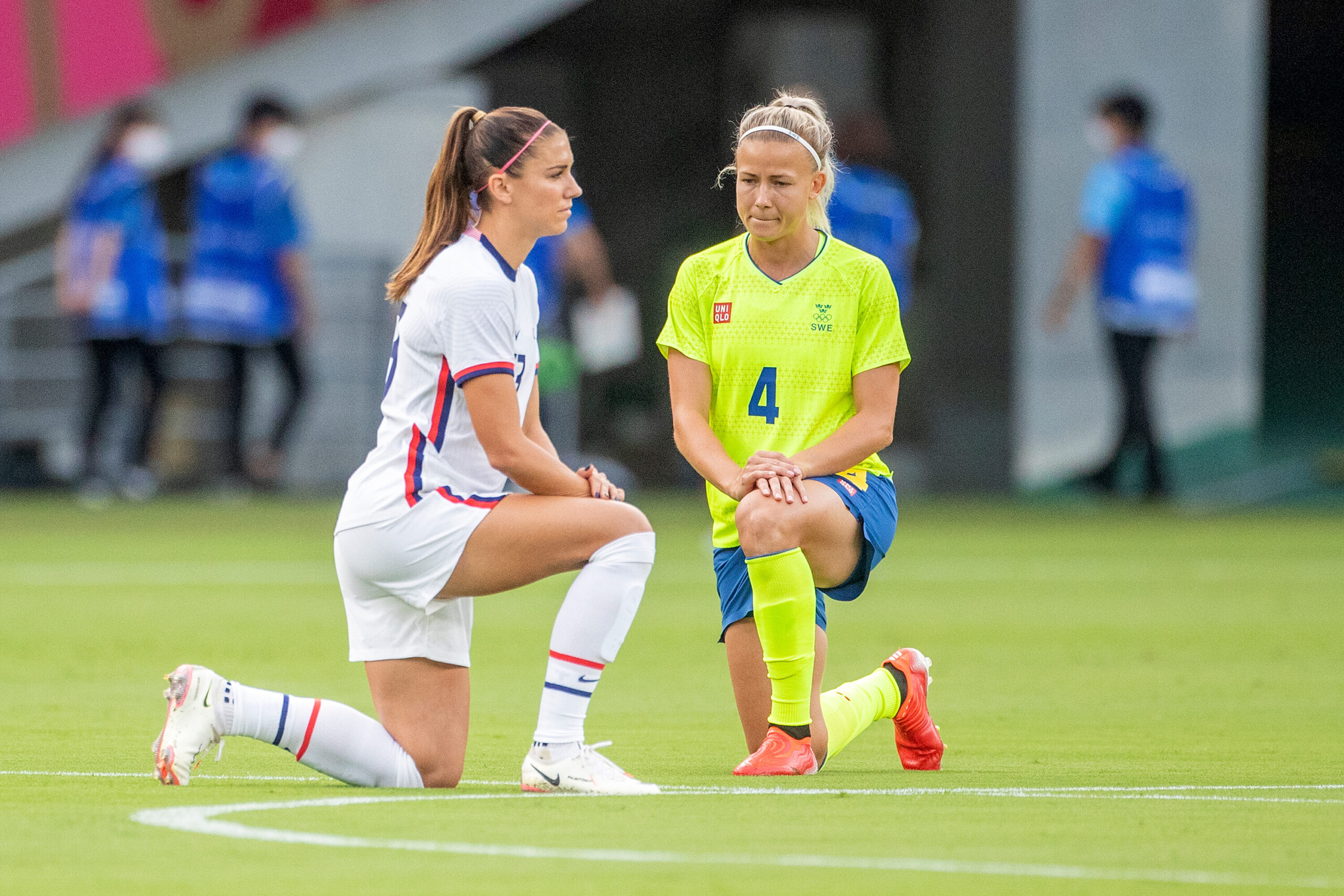 <i>Tim Clayton/Corbis Sport/Getty Images</i><br/>Alex Morgan of the US and Hanna Glas of Sweden take a knee before the start of their match.