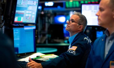 Traders work on the floor of the New York Stock Exchange (NYSE) at the opening bell on July 3