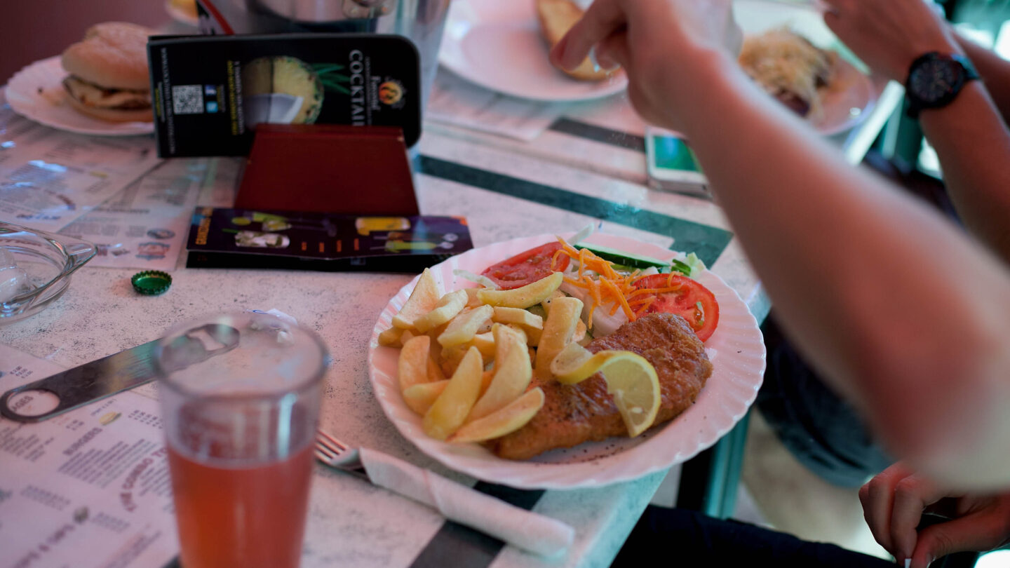 <i>Pablo Blazquez Dominguez/Getty Images</i><br/>A man adds salt to his fish and chips in a British restaurant in Benidorm