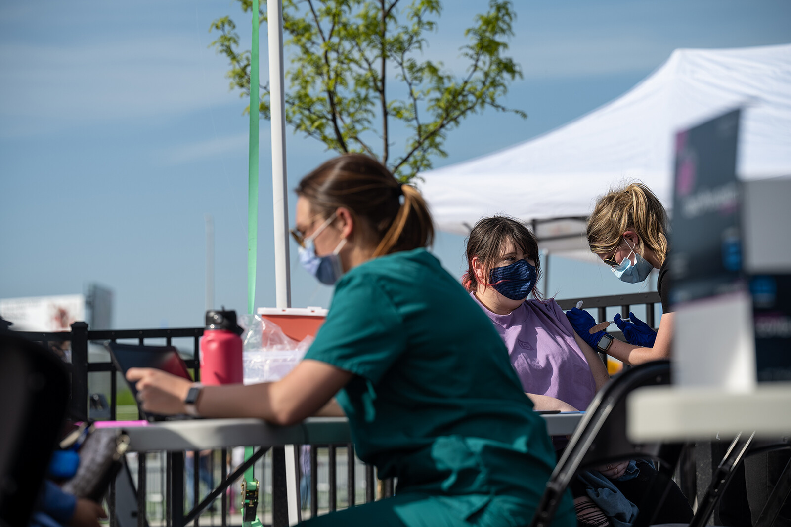 <i>Jon Cherry/Getty Images</i><br/>A nurse administers a shot of COVID-19 vaccine during a pop-up vaccination event at Lynn Family Stadium on April 26 in Louisville