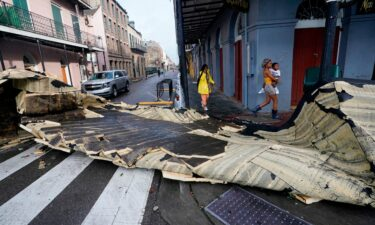 A section of roof that was blown off of a building in the French Quarter by Hurricane Ida winds blocks an intersection on August 30