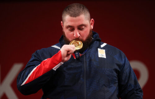 Gold medalist Lasha Talakhadze of Team Georgia poses with the gold medal during the medal ceremony for the Weightlifting - Men's 109kg+ Group on day 12 of the Tokyo 2020 Olympic Games.