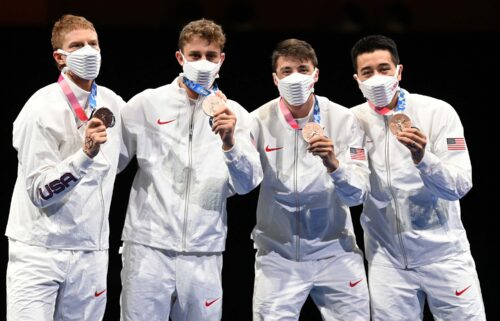 Race Imboden and his US teammates pose with their bronze medals at the 2020 Summer Olympics in Tokyo