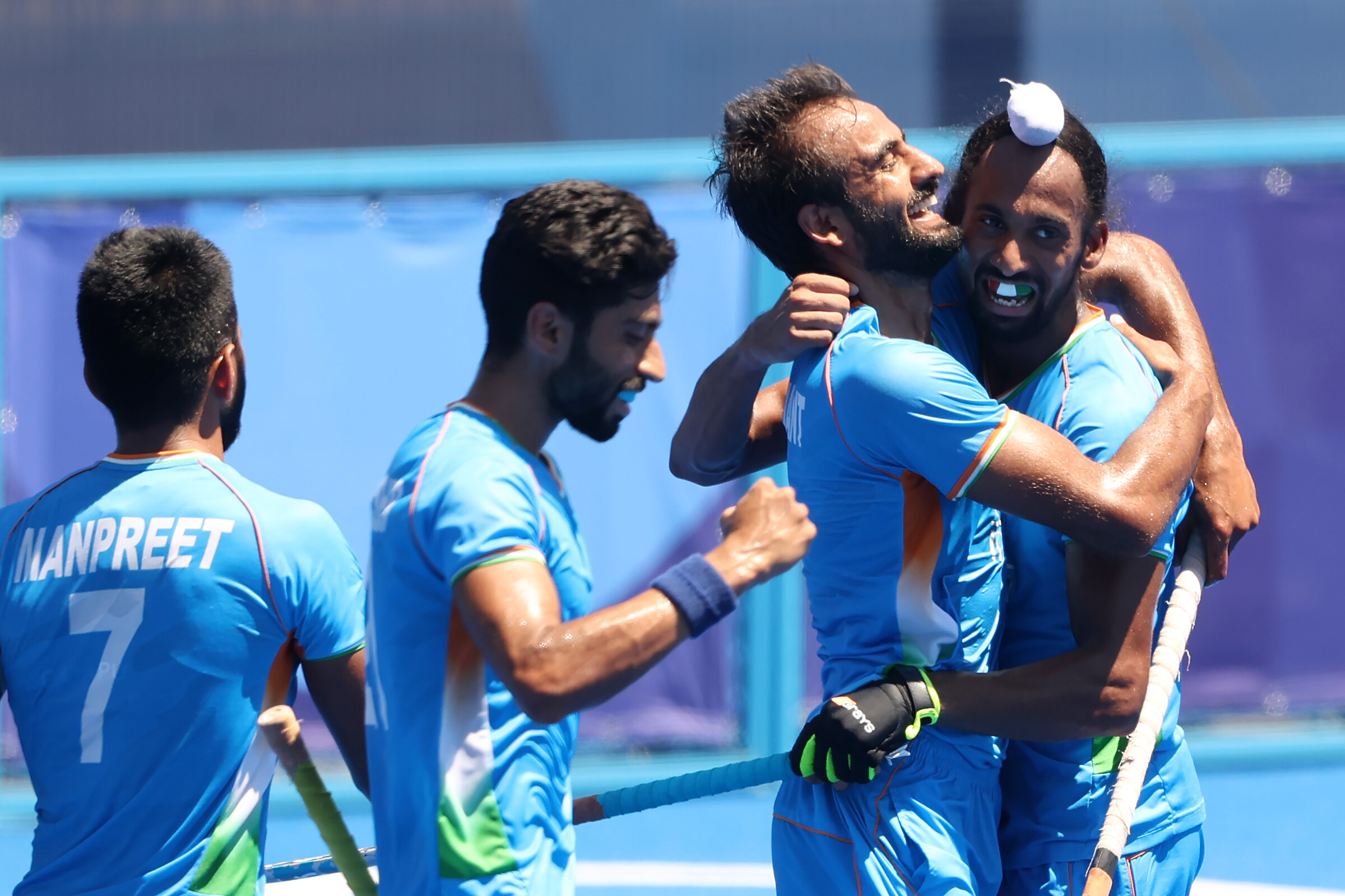 <i>Alexander Hassenstein/Getty Images</i><br/>Harmanpreet Singh celebrates scoring their third goal with teammates during the men's bronze medal match.