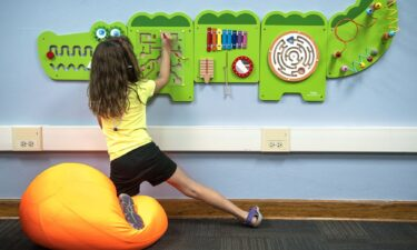 Seven-year-old Avery Walls plays with a fidget board in the new sensory room at Weeping Water Elementary School.