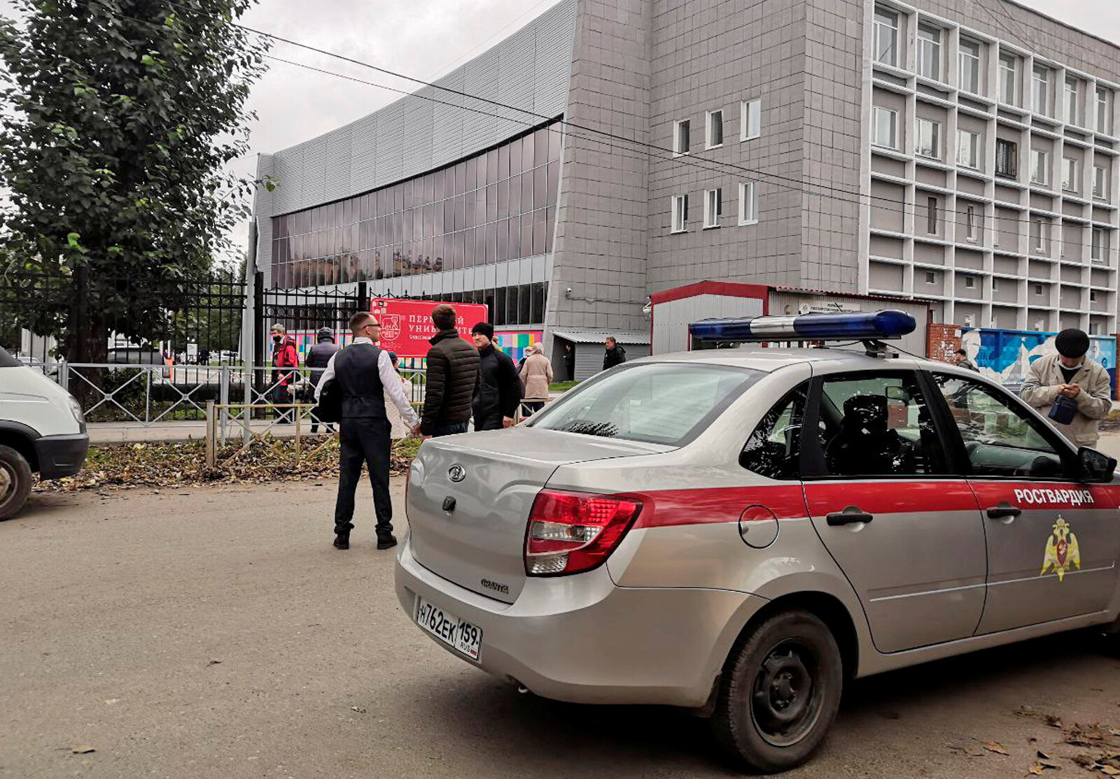 <i>Anna Vikhareva/Reuters</i><br/>A national guard car parked at the Perm State University after a gunman opened fire on Monday.