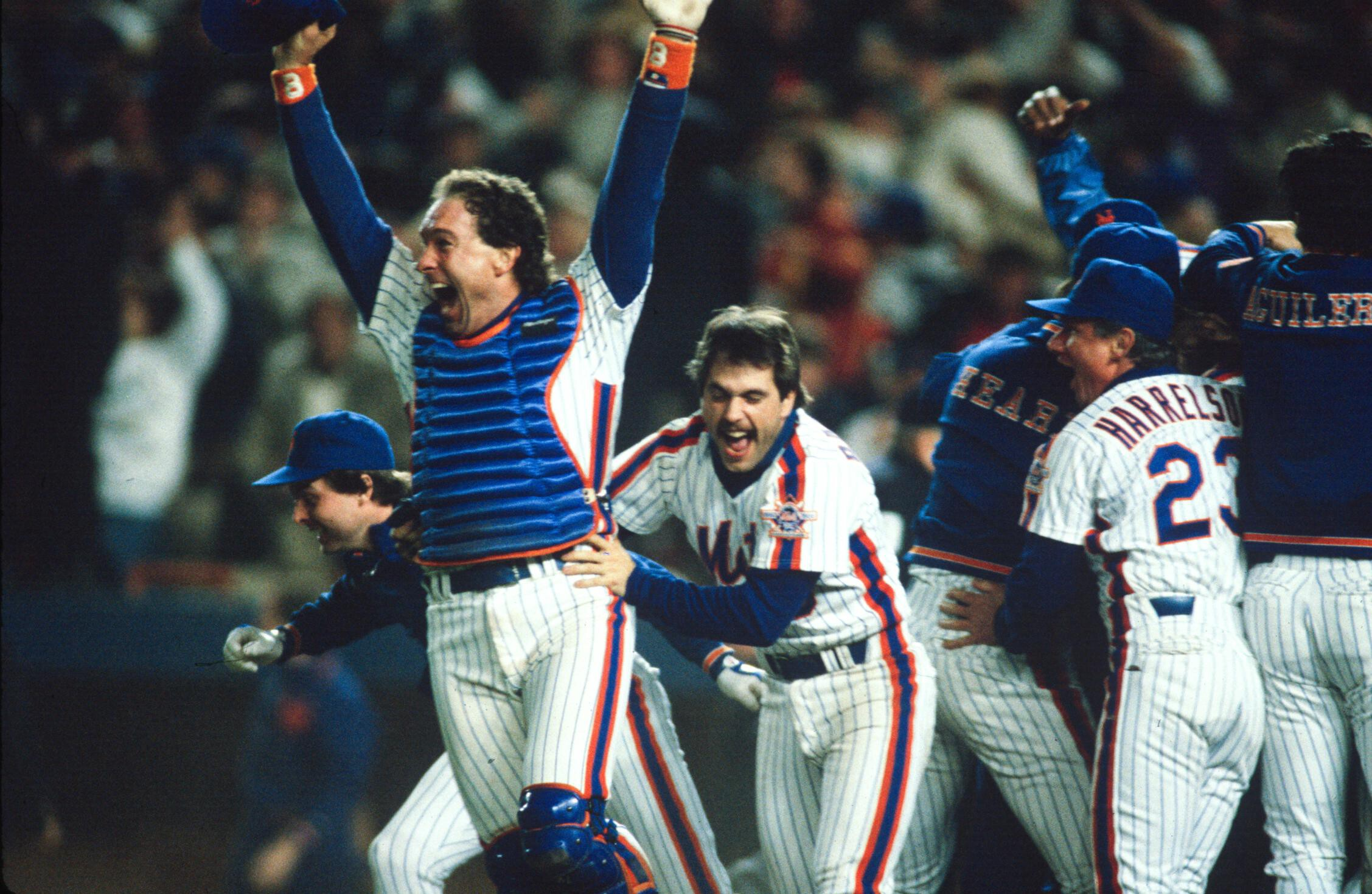 <i>MLB Photos/Getty Images/Courtesy of ESPN</i><br/>Gary Carter and Wally Backman celebrate after winning the 1986 World Series between the New York Mets and the Boston Red Sox.