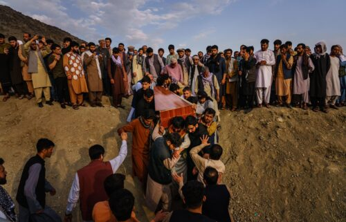 Caskets for the dead are carried towards the gravesite as relatives and friends attend a mass funeral for members of a family that is said to have been killed in a U.S. drone airstrike