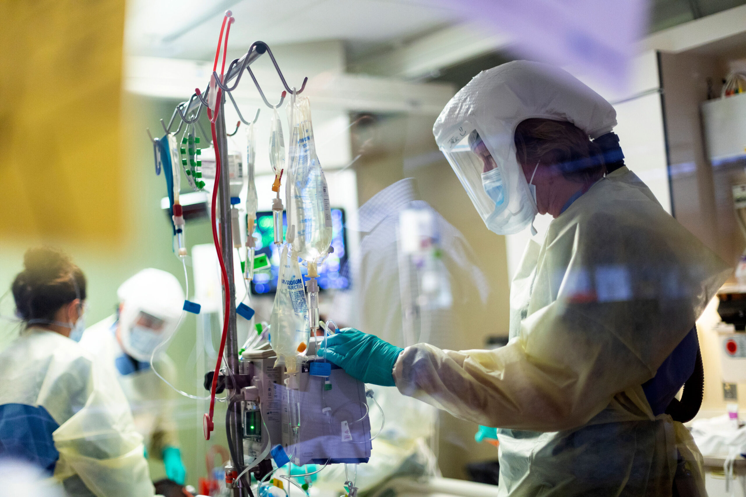 <i>Kyle Green/AP</i><br/>Jack Kingsley R.N. attends to a Covid-19 patient in the Medical Intensive Care Unit at St. Luke's Boise Medical Center in Boise