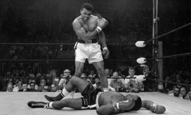 Muhammad Ali stands over Sonny Liston after dropping Liston with a short hard right on May 25