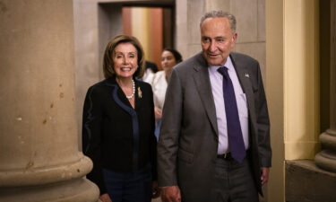 US Speaker of the House Nancy Pelosi (D-CA) and U.S. Senate Majority Leader Chuck Schumer (D-NY) emerge from the Speakers office after a bipartisan group of Senators and White House officials came to an agreement over the Biden administrations proposed infrastructure plan.