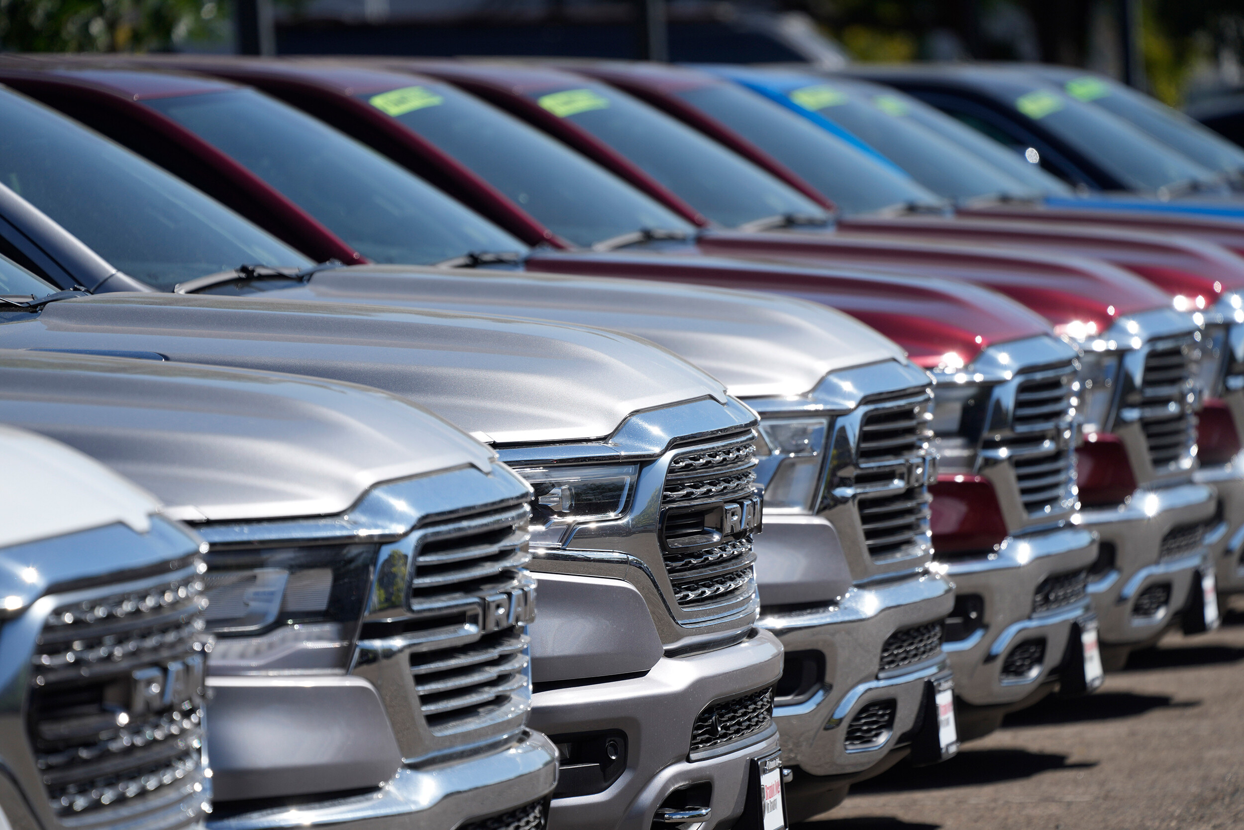 <i>David Zalubowski/AP</i><br/>A lone line of unsold 2021 pickup trucks in an empty storage lot at a Dodge Ram dealership on Sept. 12 in Littleton