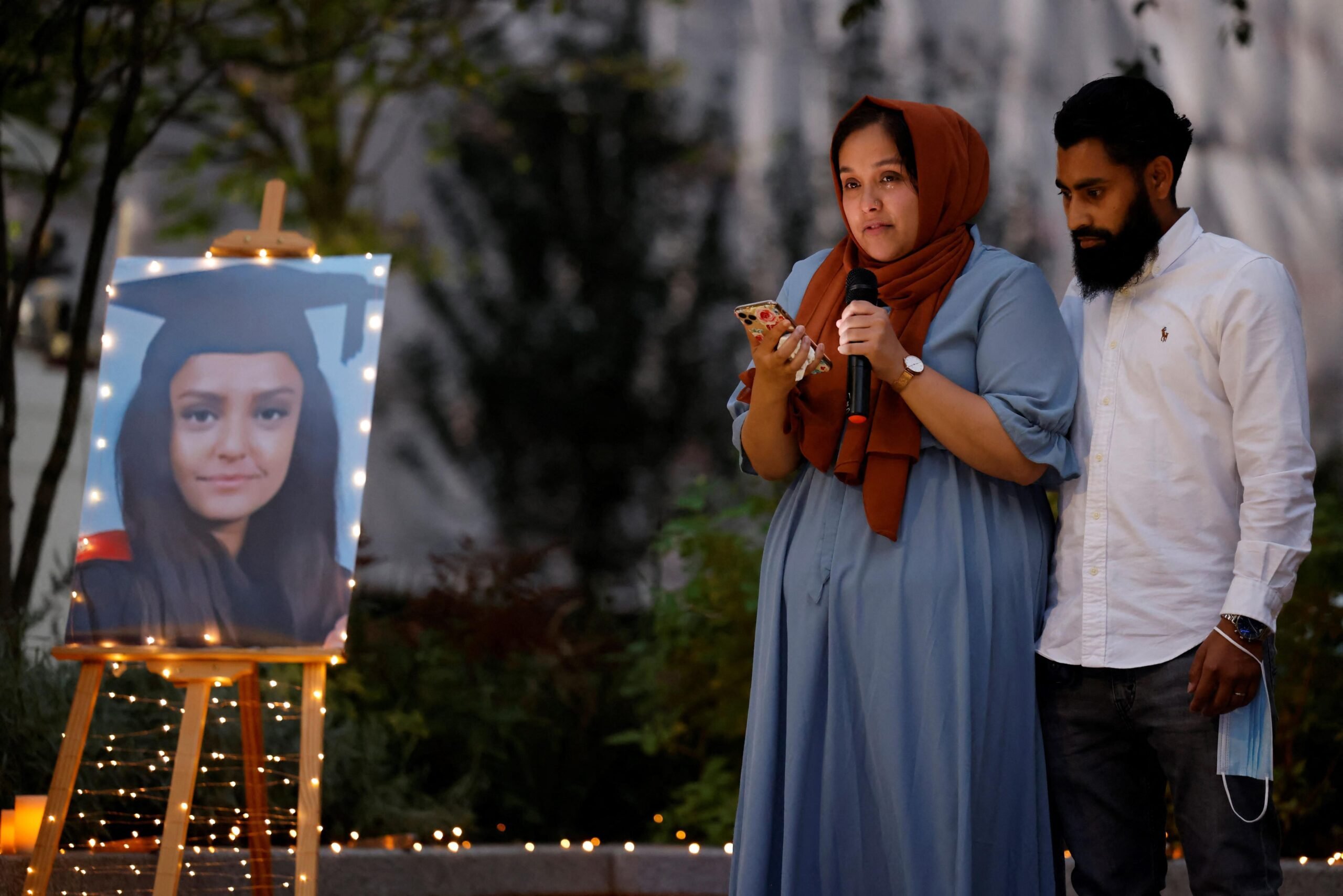 <i>Tolga Akmen/AFP/Getty Images</i><br/>Sabina Nessa's sister pays tribute to her during a candlelight vigil in Kidbrooke on September 24.