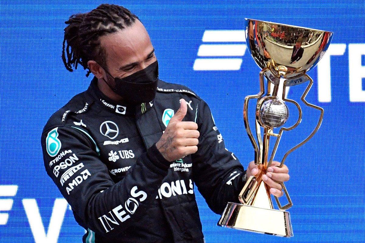 <i>Alexander Nemenov/AFP/Getty Images</i><br/>Hamilton celebrates on the podium after winning the Russian Grand Prix.