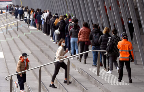 People form long queues outside a vaccination center in Melbourne on Aug. 27. Australia is on track to allow borders to reopen by Christmas