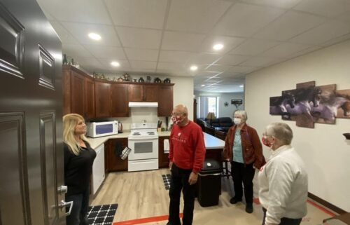 Tina Amble (left) shows off her new apartment that is in a former second-grade classroom of a building that from 1968 to 2018 was home to Arena Elementary School.
