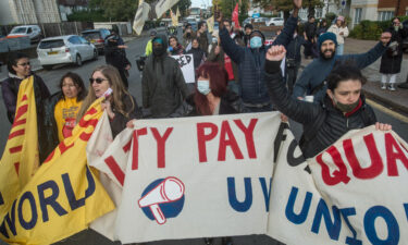 UK workers will be getting bigger paychecks starting in April following a hike to the minimum wage. Striking workers are seen here in London on October 21.