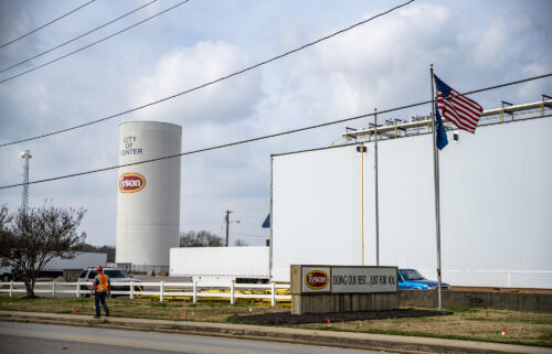 96% of Tyson's active workers are vaccinated. A worker walks past the Tyson Foods Inc. processing plant in Center