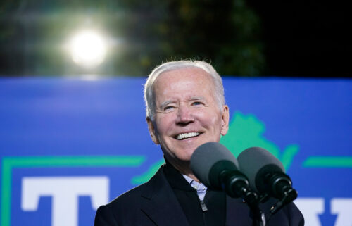 Democrats are still struggling to secure an agreement on President Joe Biden's economic agenda. Biden is seen here October 26 Arlington