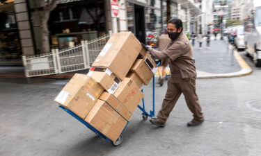 UPS just posted its best year ever. A UPS driver delivers packages in San Francisco in July.